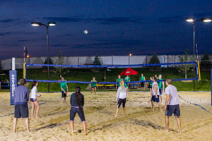 Players on the courts of Gastropub Volleyball